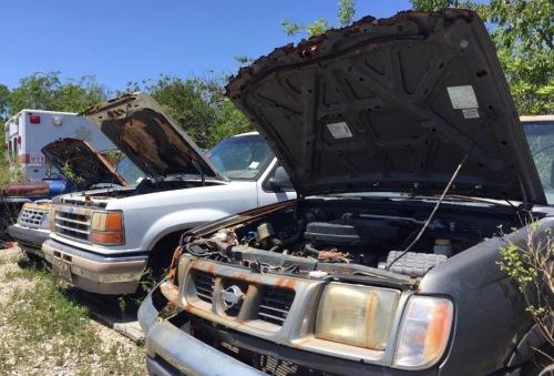 car parts at dump